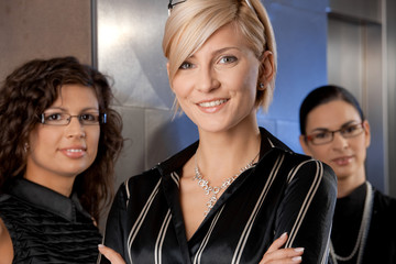 Businesswomen waiting for lift