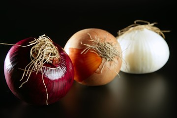 Three colorful different onion