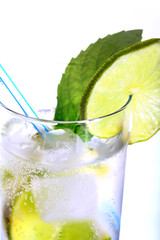 Fresh lemonade from lime with ice close up
