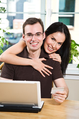 Happy couple shopping online