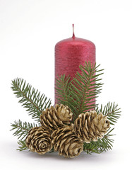 Red candle with the twig of the spruce and the cones