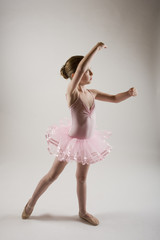 young ballerina pracicing in pink tutu