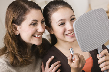 Smiling Mom and Daughter with Lipstick, Looking at Mirror