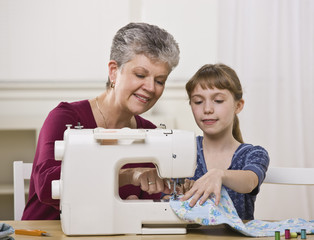Grandmother Sewing with Granddaughter