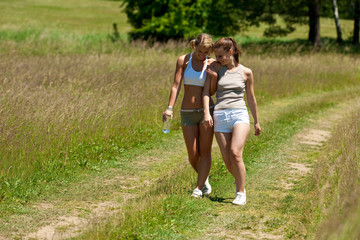 Female couple walking in nature