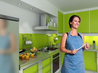 Smiling cook in a modern kitchen