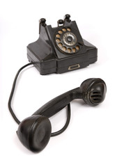 Black vintage phone with scratches