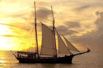 old sailing vessel at sunset