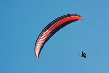 Paragliding pilot in the air