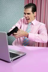 businessman young shooting handgun computer