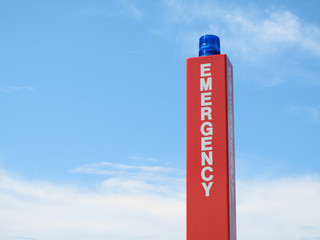 Emergency call box sign with blue strobe.