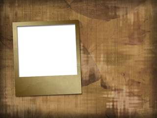 Old photoframes are hanging on the abstract background-
