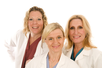 three doctors or nurses in medical lab coats