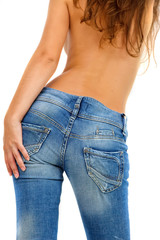 Torso of topless girl in a blue jeans