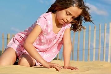 écrire dans le sable