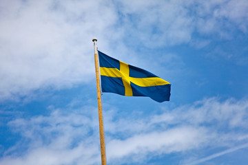 Swedish flag on blue summer sky