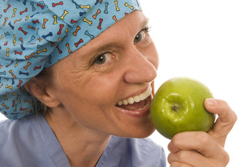 smiling happy nurse doctor eating green apple