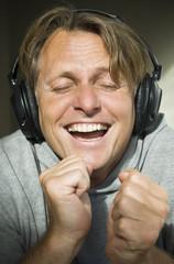 Man listening to music while wearing headphones.