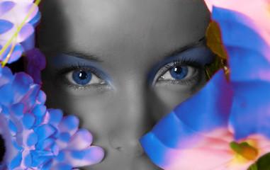 Young beautiful girl watching through flowers
