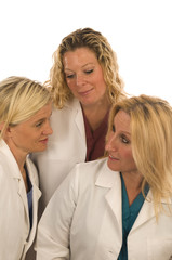 three nurses doctors medical females with happy expression