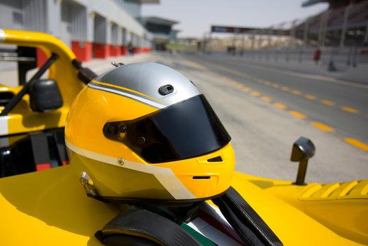 Yellow crash helmet on a sport car