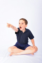 Studio shot of a young boy making faces