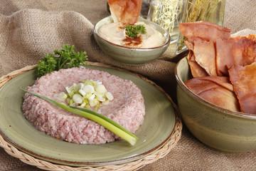 Raw kibbe, fried pitta bread, hummus tahine and olive oils
