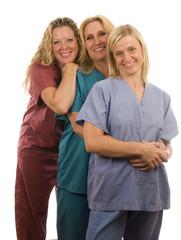 three  female doctors nurses in medical scrubs clothes