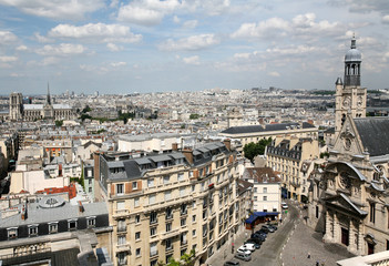 Paris skyline and high view of Church St. Etienne du Monts
