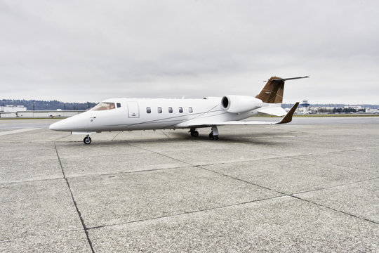 Learjet corporate aircraft profile on tarmac