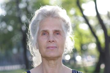 Senior woman on the nature bachground