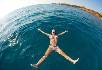 Pretty woman enjoying her swimming in the ocean
