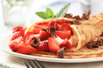 Crepes with curd cheese and strawberries