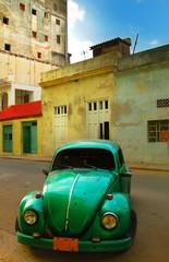 Old green car and buildings in Havana