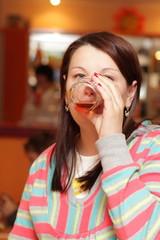 Woman drinks juice