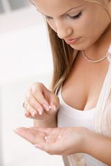 Girl taking pill
