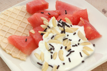 melon with wafer and fresh cream