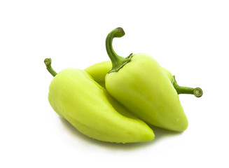 Fresh green pepper on a white background