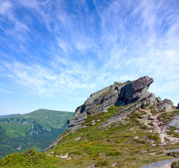 Fototapete - landscape with stones on top in mountains