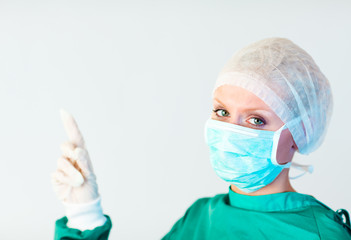 female surgeon looking upwards
