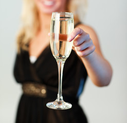 Close-up of woman holding a glass of champagne