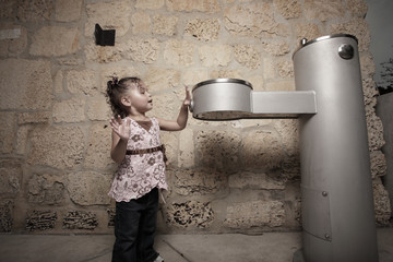 Young child at a water fountain