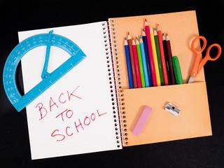 School supplies inside spiral notebook