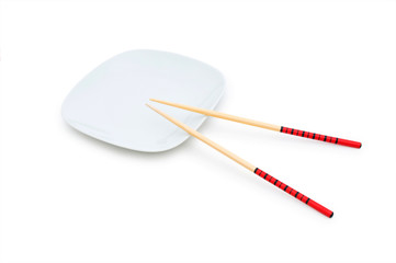 Bowl and chopsticks on the bamboo mat