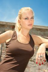 Beautiful woman posing against blue sky