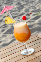 fresh summer cocktail with dessert chery and umbrella