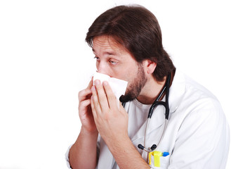 Young male doctor got fly and cleaning his nose with tissue