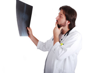 Young male doctor is looking on scan image