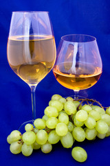 White wine and cognac with grape