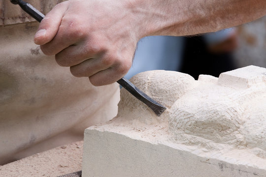 Close up of a sculptor at work